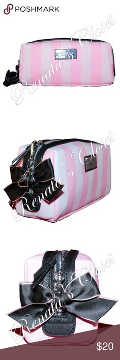 Victoria's Secret Small Beauty Bag Perfect for makeup, brushes and small beauty essentials.  * style # 3517202GMOS * color - VICTORIA STRIPE * imported satin liner * features a satin ribbon and heart dog leash clip charm * PVC shell * top zip closure * interior features 2 small zip pocket * low-maintenance * imported * photos are of the actual item for sale * smoke-free home * listing will be videotaped to protect seller from fraudulent claims Victoria's Secret Bags Cosmetic Bags & Cases