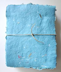 Handmade Paper with Confetti, Recycled, Blue Pack of 10 Sheets. $15.00, via Etsy.