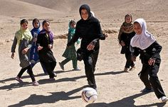Girls playing soccer close up by Trust in Education on Flickr.