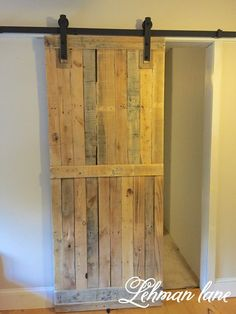 Wood Pallet Projects Come check out the Pallet Barn Door We Made using only 2 Pallets! - A pallet sliding barn door adds a lot of character, saves space, looks amazing, and is cheap and easy to make. Learn how to build it and build yours today! Pallet Crafts, Diy Pallet Projects, Home Projects, Woodworking Projects, Teds Woodworking, Woodworking Workshop, Sewing Projects, Diy Crafts, Recycled Pallets