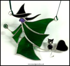 Witch on a broomstick suncatcher - spooky glass glamour for your window!