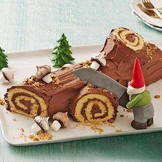 Make the season a little more jolly with this fun, easy take on the classic holiday Yule Log cake from EVERY DAY WITH RACHAEL RAY at RachaelRaymag.com A lovely moist cake, creamy chocolate buttercream and tasty honey roasted nuts; finish with a novelty ghome and christmas tree decoration, made from fondant or a clay figure.