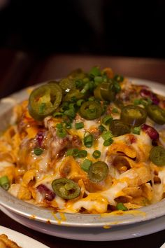 Cheesy Corn Chip #Casserole recipe with ground beef, red onion, salsa, pinto/black beans, chilis, jalapenos, sour cream, green onion, avocado