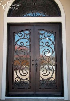 Custom wrought iron front door with full arch transom.