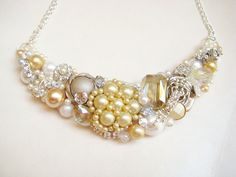 Vintage Inspired Bib Necklace with Antique Pearl Brooch- Bridal Statement Necklace in Champagne with crystals & rhinestones- Wedding Jewelry. $80.00, via Etsy.