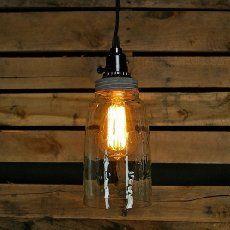 Easy mason jar crafts idea for DIY mason jar lights. Dollar store idea uses glass stones to make a cool, creative DIY project - the mason jar prism light.