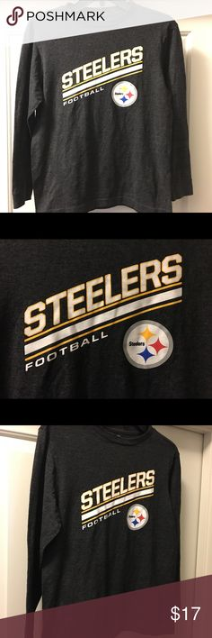 """Boys LS NFL Pittsburgh Steelers shirt sz: L 10/12 Thank you for viewing my listing, for sale is a boys, NFL brand, Pittsburg Steelers, gray, longsleeve shirt. Shirt is in very good condition. No rips, stains, or cracking in the screen print.  If you have any questions or would like additional photos please feel free to ask.  Sz: L 10/12  From under one arm to under the other measures appx 18"""" from the top of the shoulder to the bottom of the shirt measures appx 23"""" NFL Shirts & Tops Tees…"""