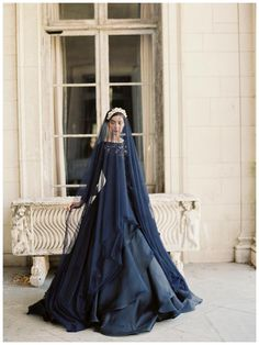"""This rich navy coloured wedding gown by Sareh Nouri is a gown for a bride who're looking for something unique, Photographed by Laura Gordon,  blue is ideal as it is considered to be a colour or wealth and good luck in many cultures or at least according to the old rhyme """"Something borrowed, something blue"""""""
