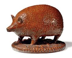 A REDWARE SALT-GLAZED HEDGEHOG  PROBABLY ENGLISH, 19TH CENTURY  5¼ in. high, 9 in. long