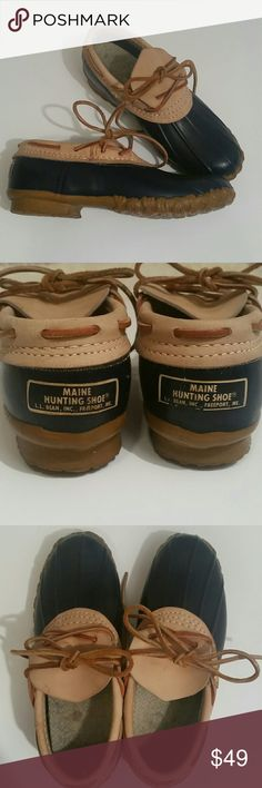 Vintage L.L Bean Duck Boots The original from Freeport, Maine.  These are so well made and sturdy. Deep navy waterproop rubber with lighter brown leather. Original laces. Soles show wear, can easily be switched out or an insole added. These are always in style! L.L. Bean Shoes Winter & Rain Boots