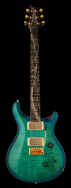 PRS Guitars | 2011 Tree of Life Custom 24. This guitar is stunning. I've been lusting over it since 2011 lol. It's limited edition guitar and isn't available anymore. Only 50 was made of this color, the other was brown. But holy shit this guitar could not get anymore perfect.