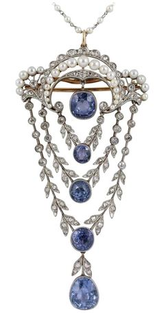 Edwardian Pendant set with Natural Ceylon Sapphires,Natural Pearls, and small Diamonds. It has a separate Platinum and Pearl chain which can be bought separately and is 17 inches long