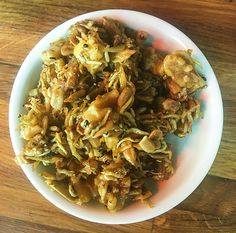 Dried neonata anchovy sprat loosely glued together with walnuts and peppitas in a sticky, sweet umami salty sauce