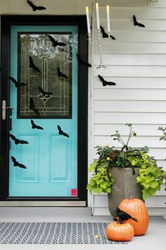 We love the flying bats and mysteriously levitating candelabra on this front porch decorated for Halloween by Darnetha Myers of ChippaSunshine. See more of her Halloween decorating ideas on The Home Depot Blog. || @chippasunshine