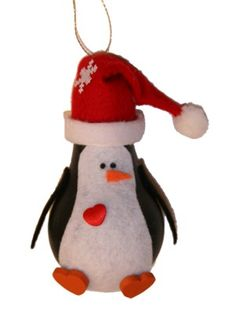 Use a burnt-out bulb and scrap felt for the Light Bulb Penguin. #Christmas #ecofriendly #tutorial