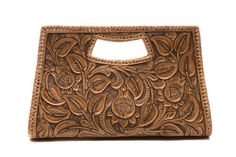 "Any well-dressed woman would be proud to own this luxurious hand-tooled clutch suitable for any cosmopolitan setting. Ideally sets off any wardrobe. This will be ""the clutch."""