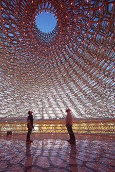 """Among the architectural extravaganzas created by the 145 participating countries at the Milan Expo 2015 - whose theme is """"feeding the planet, energy for life"""" - none has generated more buzz than the U.K. pavilion. Designed by artist Wolfgang Buttress, the project takes its cues from the honeybee. Visitors pass through an orchard and a meadow inspired by the British countryside before arriving at """"the hive,"""" an ethereal structure of honeycomb-like aluminum latticework."""