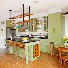 Good-Natured Green; love the color, love the natural wood, don't like the black countertops nor open shelving