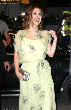The frock featured a sheer fabric over a cute white slip as she styled her hair in gentle ...