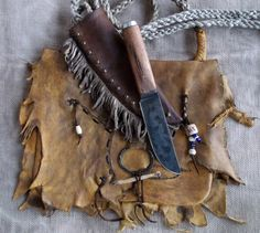 Custom built raggedy, mountain man possibles bag with primitive wormy chestnut wood handled knife in over the shoulder carry custom sheath. Made by Miss Tudy ~ Out of the Ashes Forge ~ https://www.etsy.com/shop/misstudy