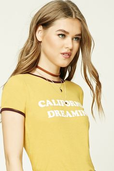 """A slub knit ringer tee featuring a """"California Dreaming"""" graphic, round neckline, short sleeves, and a ribbed trim."""