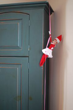 Elf on the shelf - climbing a ribbon rope