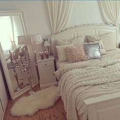 Mirror propped diagonally in the corner. Curtains for a headboard. Fuzzy faux-fur rug.