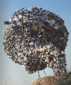 "Artist Nancy Rubins' sculpture ""World's Apart,"" 45 feet tall, composed of used appliances such as sinks, and t.v.s"