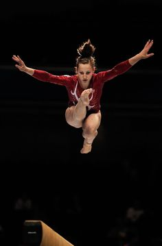 Canada's 17-year-old Dominique Pegg performs on the Beam aparatus in the Women's Qualification during the day one of the Artistic Gymnastics World Championships Tokyo 2011 at Tokyo Metropolitan Gymnasium on October 7, 2011 in Tokyo, Japan