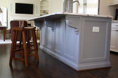 grey island  traditional kitchen by Hardwood Creations