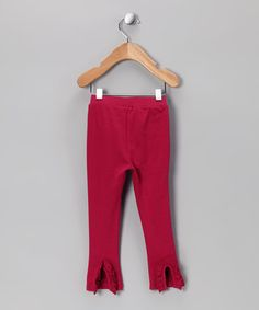Constructed from rich pima cotton, these leggings are a super-sweet, super-soft style choice with a surprise in back. Ruffles line a slit at the bottom of each leg, making this pair easy to pull on and a darling delight to wear.
