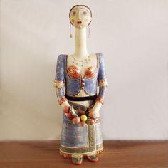 http://arktosart.com/811-thickbox_default/keramiko-glypto-gynaika-me-ble-foresia.jpg