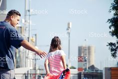 Father Reaches to Help Daughter in Urban Scene royalty-free stock photo Hand Photo, Kiwiana, Helping Hands, Scene Photo, Image Now, Royalty Free Stock Photos, Father, Daughter, Urban