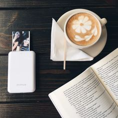 Late afternoon latte with a good book and my best friend (and her Polaroid Zip)! . ICYMI I shared my 16 fave releases of 2016 on the blog via link in bio! . I haven't been able to read much lately and it seriously sucks. I may be on a minor reading slump . I missed out on buying a @polaroid_zip when it was on sale on Black Friday but my best friend got one and we immediately printed two pictures we fell in love with this little printer  . . {#bookblog #bookblogger #bookblogging #bookish…