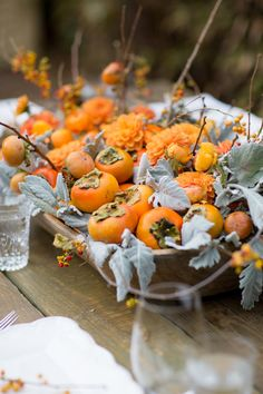 Thanksgiving centerpiece idea with persimmons photo: anna costa #sbchic