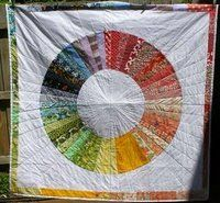 Another color wheel quilt - I like the additional border.