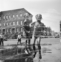 Two children jumping through a water hydrant's shower on a New York street. Orlando/Getty Images, 1950
