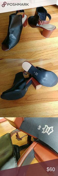 🆕🔥NWOT ROCKABILLY PEEP TOE BOOTIE SIZE 41 🆕🔥🔥NWOT BLACK/BROWN ROCKABILLY PEEP TOE BOOTIE.  SIZE 41.  FITS LIKE 9.5.  OPEN HEEL.  REAR BUCKLE STRAP.  VEGAN LEATHER.  SUPER CUTE. Shoes Ankle Boots & Booties