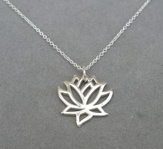 sterling silver lotus charm necklace by by rockedjewelry on Etsy, $35.00
