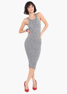 A chic midi dress! This dress has ribbed fabric throughout with a high neckline. Wear this dress with leather jacket and flat sandals or pumps and a clutch!
