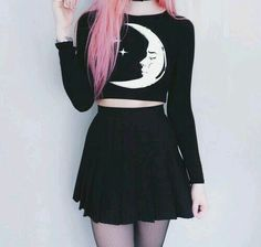 Long sleeved crescent moon black crop top, and black skater skirt.