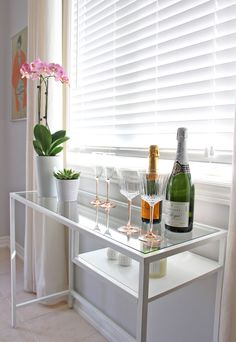 Ikea Vittsjo laptop table as a console table in my kitchen dining room, vintage blush pink Luminarc stemware