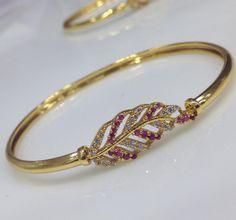 http://swarnakshi.com/product/leaf-shape-cz-and-ruby-stone-bracelet/