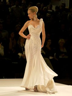 From his fashion studio, located 3 avenue Matignon, in Paris' couture golden triangle, the designer has conceived fairy-tale wedding dresses, three of which have since become this season's flagships:  Looking like a princess, the first model wore an embroidered bustier dress which lines and see-through bustier constitute a real tribute to French Couture' savoir-faire. Swarovski crystals highlight the beauty of the bride, Parisian style.  www.hayariparis.com