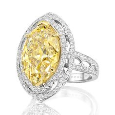 An exquisite piece from the Vintage Lace collection, which takes its inspiration from sensuous antique lace. Featuring an exceptional fancy vivid yellow marquise diamond of over 10 carats, delicately surrounded by white diamonds.