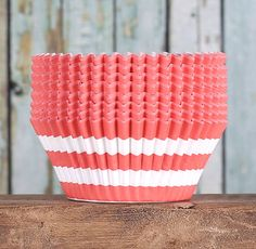 BakeBright™ coral cupcake liners in stripe print are high quality greaseproof baking cups where the colors stay bright after baking, even with darker cakes. Use for celebration cupcakes as well as eve