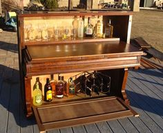 Or convert an old piano into an impressive bar. | 15 Bits Of Trash That Are Actually Treasure