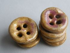 beautiful hand made ceramic buttons - I will make some buttons so the bride can get them fired.