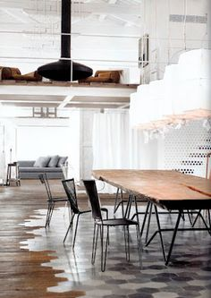 beautiful industrial interior by paola navone.  love the cut in tile in the hardwood floors. #industrial #loft #hexagon