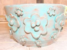 Hand thrown one of a kind bowl.Bluish, light teal colored glaze., raised flowers added for a specil touch. food safe, hand wash by GabiLuBoutique on Etsy